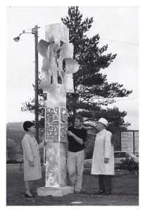 1965:  Harold Balazs highlights details of his sculpture for the First National Bank in Spokane, Washington.